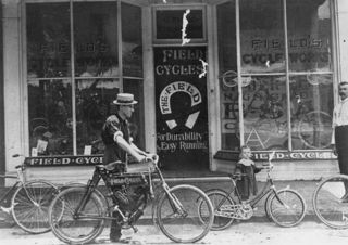 StateLibQld_2_273203_Field_Cycles_store-front_and_cyclists