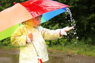 Bigstock-Little-Girl-With-An-Umbrella-I-46275763