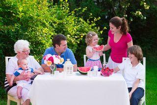 Bigstock-Big-Family-Having-Lunch-Outdoo-93074627