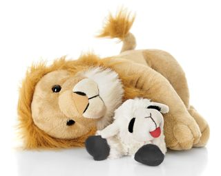 Bigstock-A-toy-lamb-and-lion-peacefully-89797469