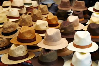 Hats-in-outdoor-store-stacked--119670740