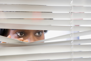 Bigstock-Woman-looking-through-blinds-118708964