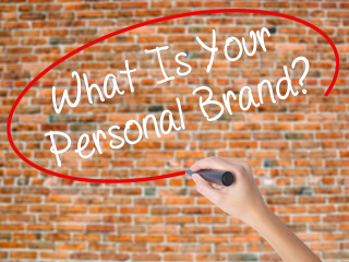 Bigstock-Woman-Hand-personal branding Writing-What-Is-You-171091214