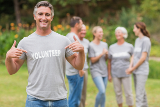 Bigstock-Happy-volunteer-showing-his-t--91522190
