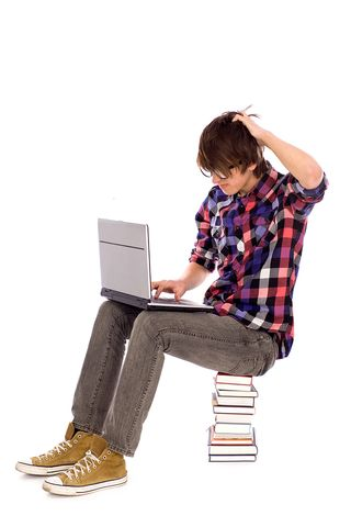 Bigstock-Student-sitting-on-stack-of-bo-15006581