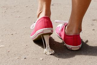 Bigstock-Foot-stuck-into-chewing-gum-on-69233833