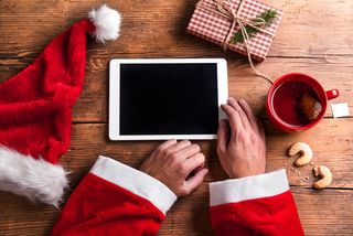 Bigstock-Santa-Claus-with-tablet-106030700