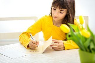 Bigstock-cute-little-girl-making-a-card-65944081