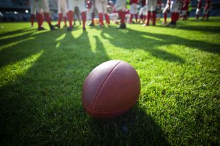 Bigstock-american-football-on-stadium-w-94057235