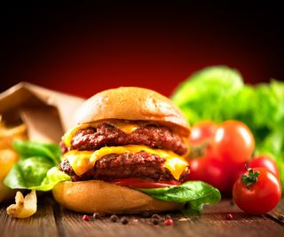 Bigstock-Hamburger-with-fries-on-wooden-87149594