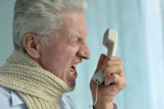 Angry senior on phone bigstock--128748236