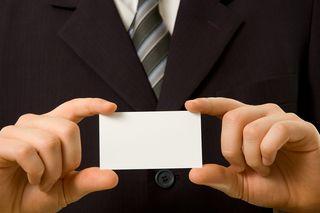 Bigstock-Businessman-Holding-Blank-Busi-2996466