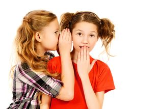 Bigstock-Two-girls-whispering-to-each-o-79600147