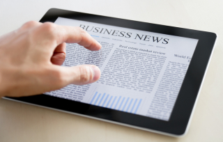 Business-News-On-Apple-Ipad-22811570