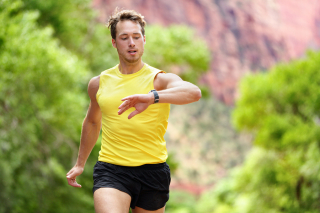 Bigstock-Runner-looking-at-heart-rate-m-89890631