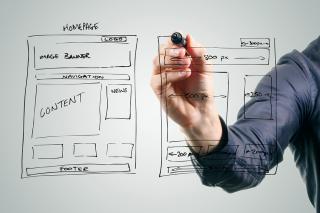 Bigstock-Designer-Drawing-Website-Devel-59318615
