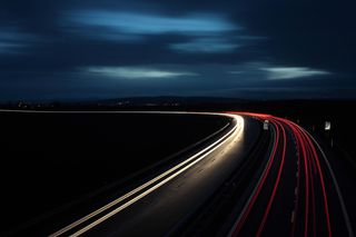 Bigstock-Cars-moving-fast-on-a-highway--16427273