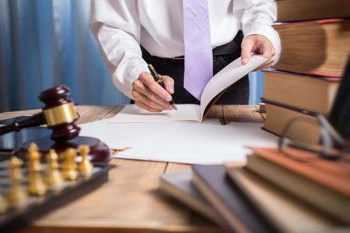 Bigstock-Young-Lawyer-Business-Man-Work-163880573